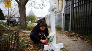 Two makeshift memorials were in place today outside the Southwest Side home where a firefighter suffered fatal injuries Friday evening, and results of an initial investigation remained undetermined until further tests can be done on a water heater.