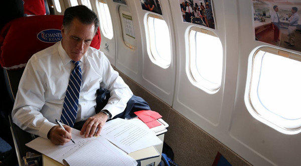 Mitt Romney works aboard his campaign plane Friday in Columbus, Ohio.