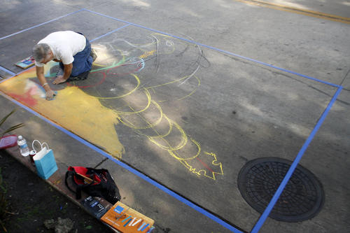 Oscar de Leon uses chalk to draw his 10' x 10' piece during Downtown Burbank ARTS Festival, which took place on San Fernando Rd. between Magnolia Blvd. and Olive Ave. on Saturday, November 3, 2012.