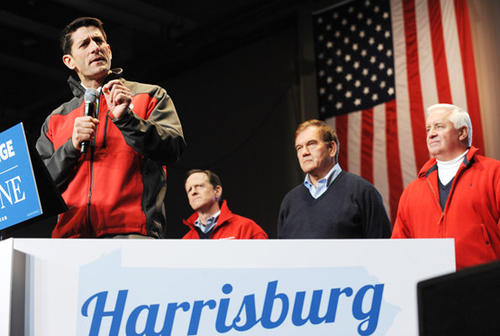 Republican Vice Presidential candidate Paul Ryan, left, addresses a rally at Harrisburg International Airport Saturday. Behind him are from left: Sen. Pat Toomey, former Governor Tom Ridge and Governor Tom Corbett.