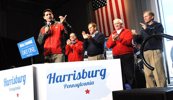 Republican Vice Presidential candidate Paul Ryan, left, addresses a rally at Harrisburg International Airport Saturday. Behind him are from left: Sen. Pat Toomey, former Governor Tom Ridge, Governor Tom Corbett and Va. Governor Bob McDonnell.