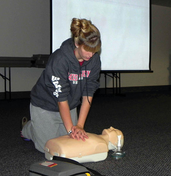 Alyssa Weagley of Chambersburg, Pa., practices chest compressions on a mannequin Saturday at the Heartsaver CPR class at Chambersburg Hospital sponsored by the American Heart Association and Franklin County Department of Emergency Services.