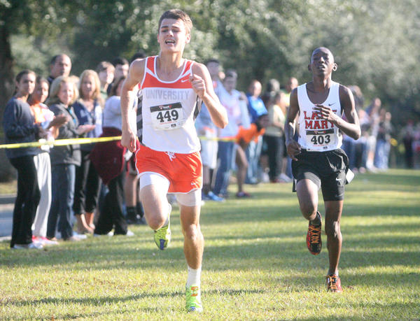 Orange City University's Christopher Westfall gets second and Lake Mary's Ryan DeGale finishes third in the FHSAA Class 4A, District 2 Cross Country Championship at Seminole State College in Oviedo, Florida on Saturday, Nov. 3, 2012.