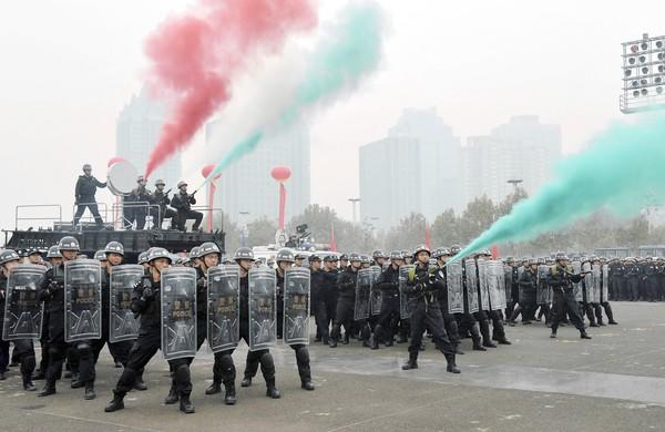 Chinese police officers practice crowd dispersal in advance of the 18th Communist Party Congress that will be held in Beijing this week.
