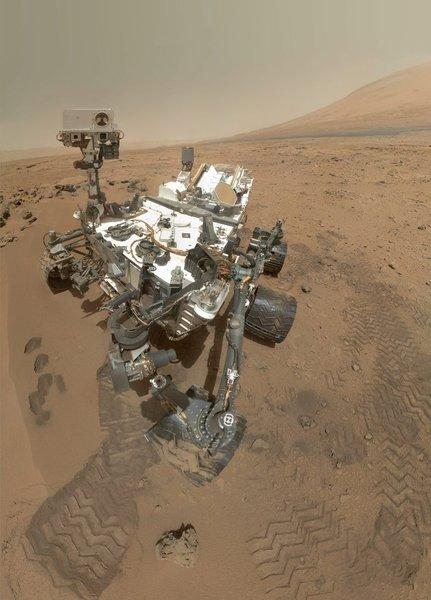 "NASA's Curiosity rover on Oct 31. The mosaic shows the rover at ""Rocknest,"" the spot in Gale Crater where the mission's first scoop sampling took place. Four scoop scars can be seen in the regolith in front of the rover."