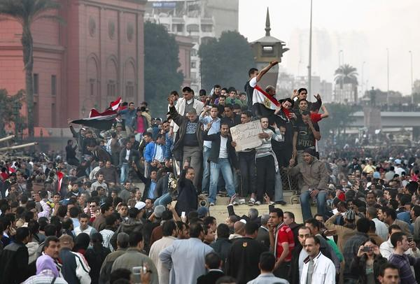 Protesters celebrate in Cairo amid the 2011 revolution. The Ultras joined the cause, jumping into violent clashes with backers of Hosni Mubarak.