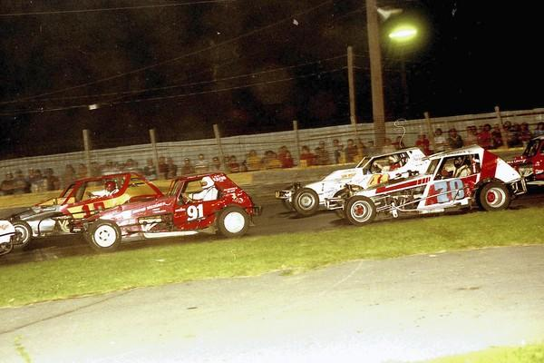 Race cars circle the track at the old Dorney Park Speedway.