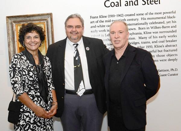 Elissa Garofalo (left), president and executive director of the Delaware & Lehigh National Heritage Corridor; Dale Freudenberger, Anthracite Region Coordinator for the corridor, and artist David Watkins Price take in the Allentown Art Museum's 'Franz Kline: Coal and Steel' exhibit during a preview party for that show and 'Walker Evans & The American Landscape Social Photographers.'