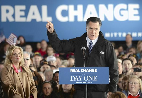 Republican presidential nominee Mitt Romney rallies supporters at the regional airport in Dubuque, Iowa, during a three-state campaign swing on the final weekend before the election.