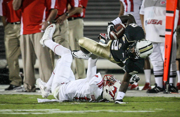 UCF wide receiver Jeff Godfrey (2) is brought down by SMU's Chris Parks (1) during first quarter action of a C-USA football game against SMU at the Brighthouse Networks Stadium on Saturday, November 03, 2012 in Orlando, Fla.