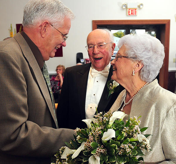 Newlyweds Robert Krempels and Virginia Perna, right, are greeted after their wedding by Virginia Avenue Church of God associate pastor Glen Garner.