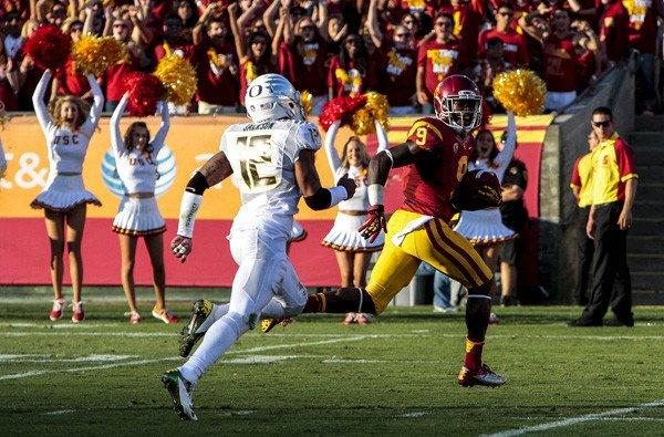 Trojans receiver Marqise Lee beats Ducks defensive back Brian Jackson to the end zone for a touchdown in the first half Saturday.