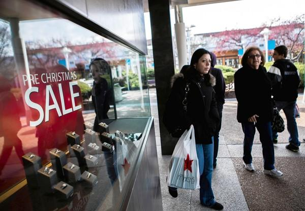 Chicago-area consumers, such as these shoppers at Oakbrook Center, plan to spend about 10 percent more on gifts this year, according to a new Deloitte survey. The National Retail Federation has more conservative estimates for the country at large, predicting a 1 percent increase.