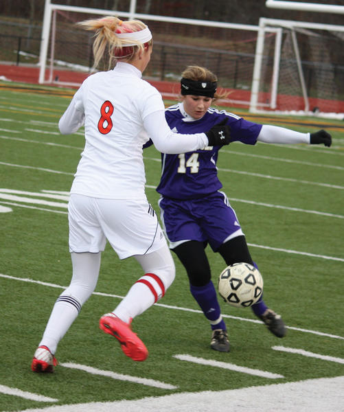 Smithsburg junior Haley David (14) fights for the ball against Mountain Ridge senior Carlie Lewis (8) during Saturday's Maryland Class 1A West girls soccer semifinal.