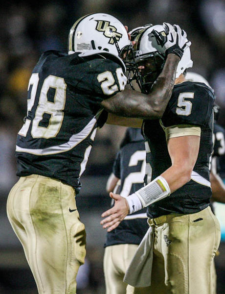 UCF running back Latavius Murray (28) celebrates with quarterback Blake Bortles (5) after scoring a touchdown during third quarter action of a C-USA football game against SMU at the Brighthouse Networks Stadium on Saturday, November 03, 2012 in Orlando, Fla.