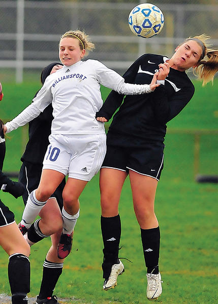Williamsport's Ashley Likely (10) battles Oakdale's Tanner Bradley for the ball in the first half of Saturday's Maryland Class 2A West girls soccer semifinal at Williamsport.