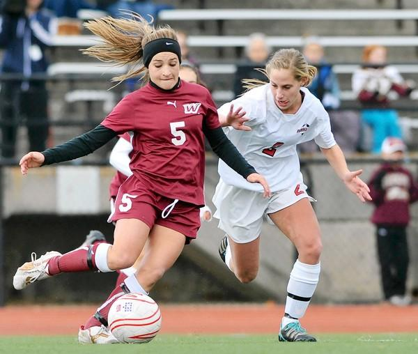 Parkland's Taylor Coleman (2) battles for the ball against Whitehall's Taylor George (5) during District 11 girls soccer finals at J. Birney Crum Stadium on Saturday afternoon.