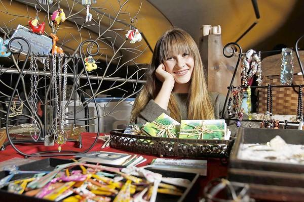Ali Pfleger, 13, of Newport Beach is selling hand-beaded and wire jewelry to raise money for the charity, Giving it Back to Kids, at the annual Mariners Church Women's Ministries Christmas Boutique.