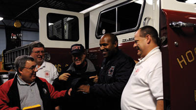 Hooversville Volunteer Fire Co. and West Hamilton Beach Volunteer Fire Department near Queens, N.Y., exchange fire department T-shirts and hats at the Hooversville Fire Hall on Saturday. The Hooversville fire department donated a $25,000 fire truck to the New York fire department. From left: Hooversville fire department President Richard Lohr, Hooversville fire Chief James Karashowsky, West Hamilton Beach fire department treasurer Mitch Udowitch, West Hamilton Beach fire department Capt. Ronald Corchado and Hooversville fire department assistant chief Mike Shumaker.