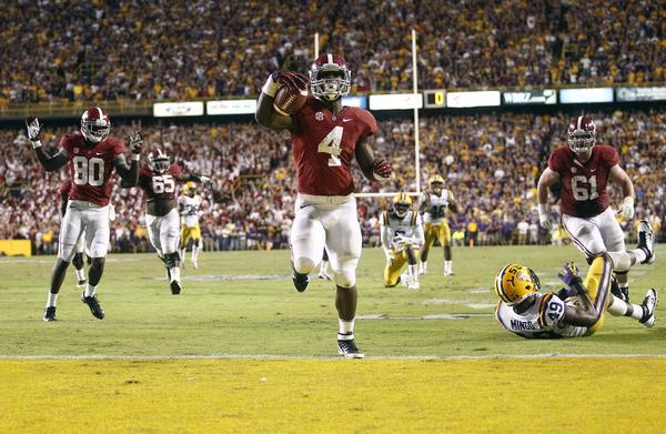 Alabama running back T.J. Yeldon scores the game-winning touchdown during the fourth quarter against LSU.