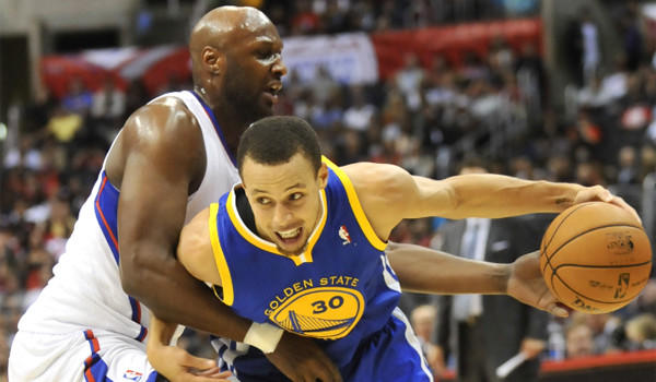 Lamar Odom, left, defends Golden State's Stephen Curry, who scored 23 points in the Warriors' 114-110 victory over the Clippers at Staples Center on Saturday night.