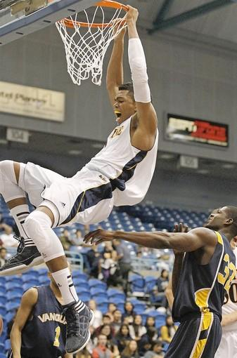 UC Irvine's Will Davis dunks the ball during the first half against Vanguard in an exhibition game at the Bren Events Center on Saturday.