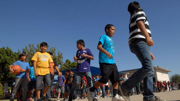 Students walk towards the school playground during recess at Miguel Hidalgo Elementary School