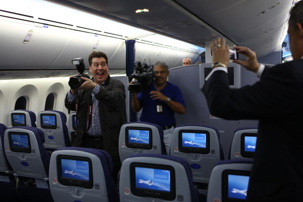 Top United Airlines passenger Peter Shankman (left) takes a photo in the cabin of the Boeing 787 Dreamliner aircraft on Sunday. This is the inaugural  flight from Houston to Chicago for the Dreamliner aircraft, which is touted as being much more fuel efficient than any other similar plane and has a host of passenger amenities, such as larger windows, special lighting and filtered air.