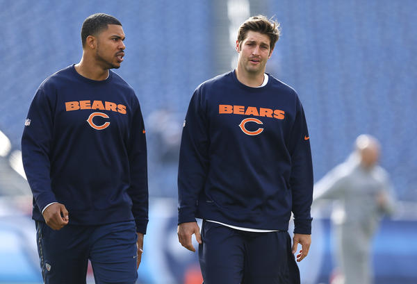 Chicago Bears quarterback Jason Campbell (left) chats with Chicago Bears quarterback Jay Cutler (right) during pre-game warm ups before a game against the Tennessee Titans at LP Field in Nashville, Tenn. on Sunday.