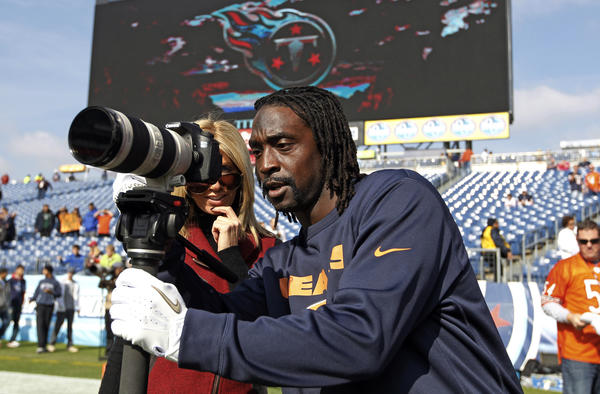 Chicago Bears cornerback Charles Tillman (33) borrows some camera equipment before playing the Tennessee Titans on Sunday.