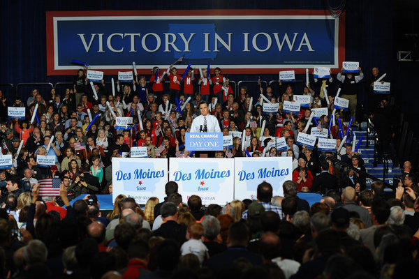 Supporters of Mitt Romney cheer during a rally in Des Moines.