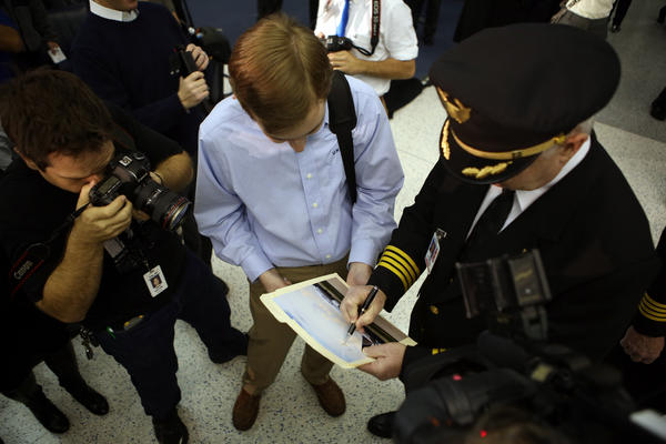 An enthusiast gets Captain Jim Starley's autograph before he pilots United Airlines' inaugural flight of the Boeing 787 Dreamliner Sunday at George Bush Intercontinental in Houston, Texas.