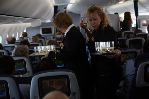 The crew hands out sparkling wine for a toast during United Airlines' inaugural flight of the Boeing 787 Dreamliner aircraft Sunday, before the plane departed from George Bush Intercontinental Airport in Houston, Texas.