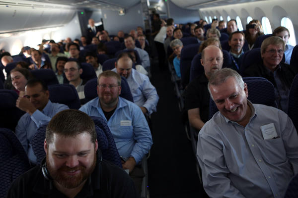 Passengers listen as United Airlines CEO Jeff Smisek offers a toast during United Airlines' inaugural flight of the Boeing 787 Dreamliner aircraft Sunday, before the plane's departure from George Bush Intercontinental in Houston, Texas.