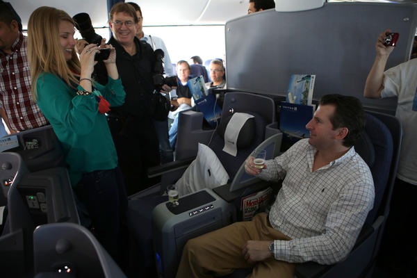 Summer Hull of Houston, photographs Les Tarrance, also of Houston, Texas, as he sits in business class during United Airlines' inaugural flight of the Boeing 787 Dreamliner aircraft Sunday, before the plane departed from George Bush Intercontinental Airport in Houston, Texas.