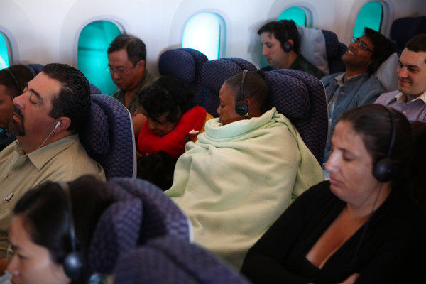 Passengers get comfy during United Airlines' inaugural flight of the Boeing 787 Dreamliner aircraft Sunday. The flight took passengers from George Bush Intercontinental Airport in Houston to Chicago's O'Hare Airport.