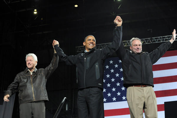 President Obama, center, former president Bill Clinton, left, and Senate candidate Tim Kaine from Virginia wave at supporters during a campaign rally at Jiffy Lube Live in Bristow, Va. on Nov. 3.