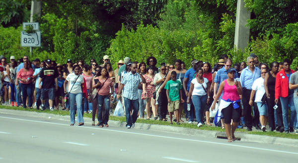 The line of people waiting to see President Barack Obama on Sunday stretched for miles down Pines Boulevard in Hollywood.