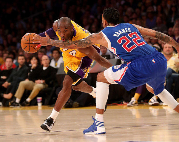 Lakers guard Kobe Bryant drives against Clippers forward Matt Barnes. Steve Nash wasn't on the court for the game.