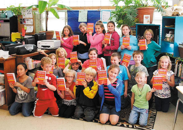 Shown are students in Ms. Gentry's third-grade class at Shepherdstown Elementary School displaying the dictionaries they received on Oct. 16. The Rotarians who distributed the books that day were Dana Orsini and Michelle Liefke.