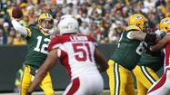 GREEN BAY -- Aaron Rodgers threw four touchdown passes, two to Randall Cobb, as the Green Bay Packers kept their winning streak going with a 31-17 victory over the reeling Arizona Cardinals.