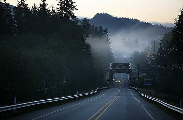 Early morning mist rolls across State Route 101 heading into Forks. Meyer had never been to the town when she started writing her books. She chose it because an Internet search showed it as the rainiest city in the Lower 48, often covered with mist -- and vampires don't like sun.