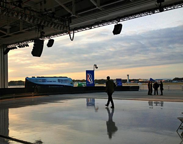 The sun begins to set behind preparations for the Romney rally at Smithfield Foods flight hanger.