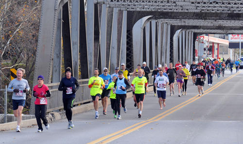 Runners cross the Northampton- Cementon Bridge on Sunday morning during the second Delaware and Lehigh Heritage Marathon and Half Marathon, that began at Atlas Park in Northampton and ended at the Lehigh Gap Nature Center on Paint Mill Road in Slatington. Over 800 registered for the run, with some coming from New York City after the New York Marathon was canceled because of power outages and damage from Hurricane Sandy.