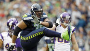 SEATTLE -- The feet of Seattle Seahawks quarterback Russell Wilson and running back Marshawn Lynch were enough to outcome those of Minnesota Vikings running back Adrian Peterson.