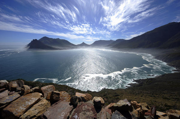 A general view of the Hout Bay harbour covered in mist is seen on May 8, 2010 from the Chapman's peak road on the outskirts of Cape Town. Chapman's peak road is the coastal link between Cape Town and the Cape of Good Hope.
