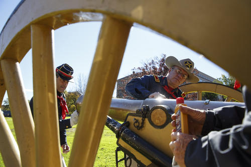 (R) Mark Yanaway  and David Wilson of the First Litchfield Artillery Regiment clean a pre- civil war reproduction canon which will be fired to officially start the Connecticut Veterans Parade.