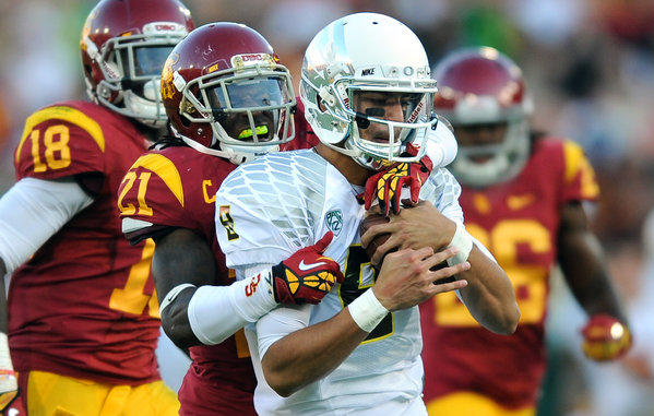 Quarterback Marcus Mariota and the Ducks were able to stay well ahead of USC in a 62-51 victory on Saturday night at the Coliseum.