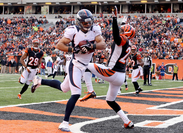 Eric Decker #87 of the Denver Broncos catches a touchdown pass while defended by Terence Newman #23 of the Cincinnati Bengals during the NFL game at Paul Brown Stadium on November 4, 2012 in Cincinnati, Ohio. Denver won 31–23.