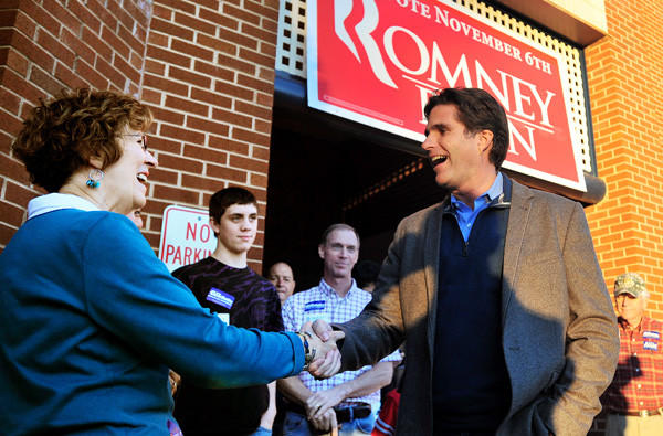 Tagg Romney greets Barbara Irby at his father's election headquarters in Lynchburg, Va., last month.